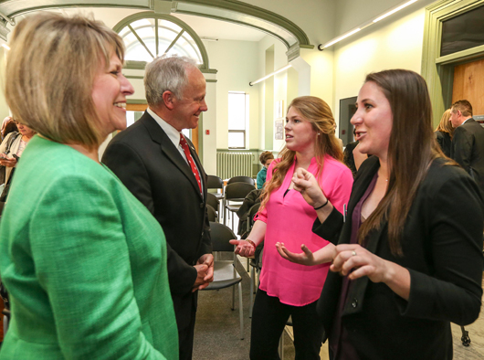 Ministers Glavine and Regan speak to 4th year nursing students Jenna Goobie and Meagan Lunn after the announcement of the new nursing strategy.