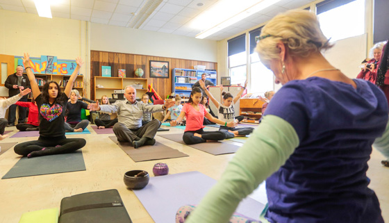 Health and Wellness Minister Leo Glavine participates in a yoga program in Wolfville.