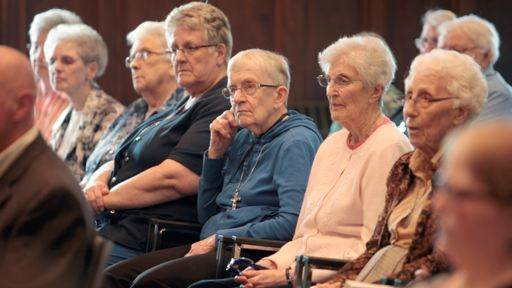 Sisters of Saint Martha listen to the announcement about a new long term care facility.
