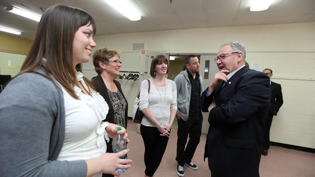 Premier Darrell Dexter talks with people from the Halifax Youth Advocate Program's Girls United, which will help girls at risk.