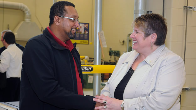 MLA Becky Kent, on behalf of Labour and Advanced Education Minister Frank Corbett, chats with Jean Claude Fortes, of NSCC, after announcing a new business program for tradespeople.
