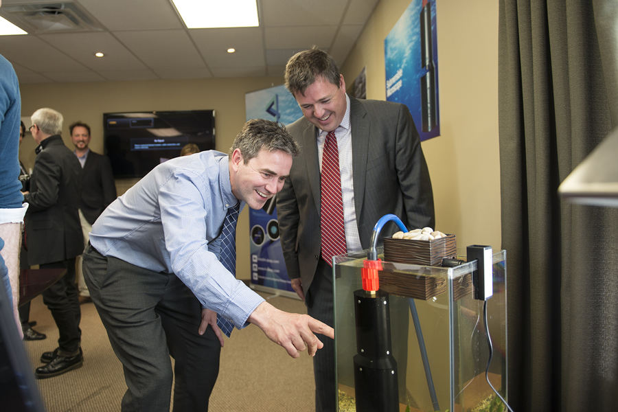 Stephen Jones, 4Deep Inwater Imaging CEO, demonstrates to Economic and Rural Development and Tourism Minister Michel Samson how the technology works.