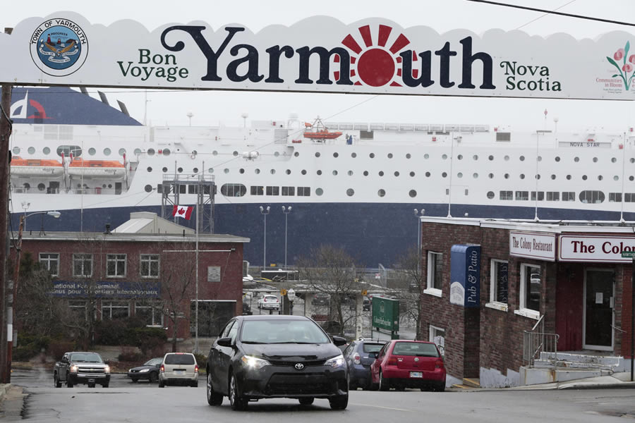 The Nova Star ferry is tied up under a large Yarmouth sign.