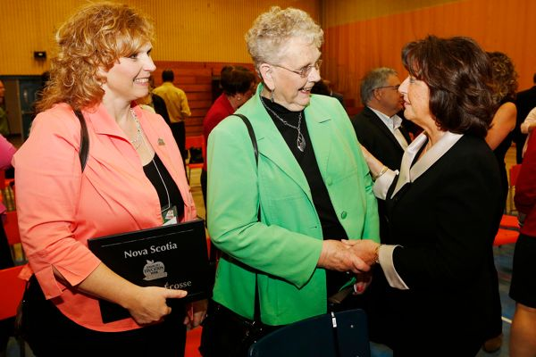 Education and Early Childhood Development Minster Karen Casey shakes hands with Letha Mowatt, (middle) a former teacher and mother of award recipient Melanie Miller, of West Hants Middle School (left).