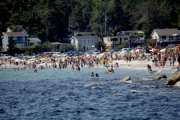 People enjoying a warm summer day at Queensland Beach near Halifax.