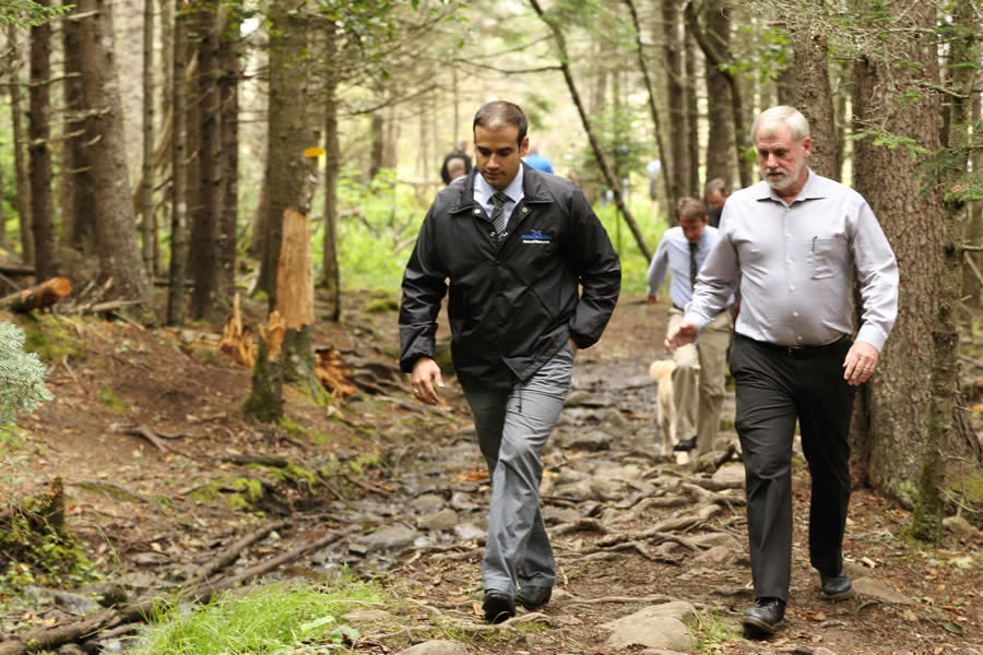 Natural Resources Minister Zach Churchill and MLA Keith Irving, who spoke on behalf of Economic and Rural Development and Tourism Minister Michel Samson, walk the reopened trail.