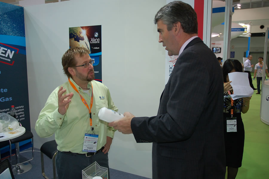 Premier Stephen McNeil chats with Darren Penney, director of business development with Xeos Technologies at Oceanology International China 2014, in Shanghai, China.
