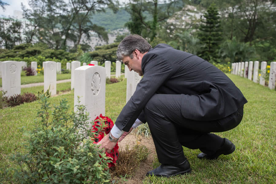 Premier Stephen McNeil places a wreath on the grave of Henry Andrew Surette of Port Bickerton, Guysborough Co., who served as a rifleman and died Dec. 25, 1941, the day the island fell to the Japanese.