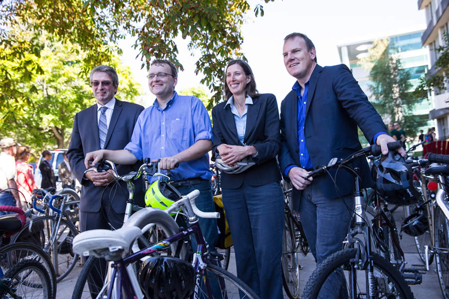 Ian Nason, vice-president of finance and admin, Dalhousie University, Coun. Waye Mason, Rochelle Owen, director, office of sustainability, Dalhousie University, and Energy Minister Andrew Younger stand with bikes at today's announcement.