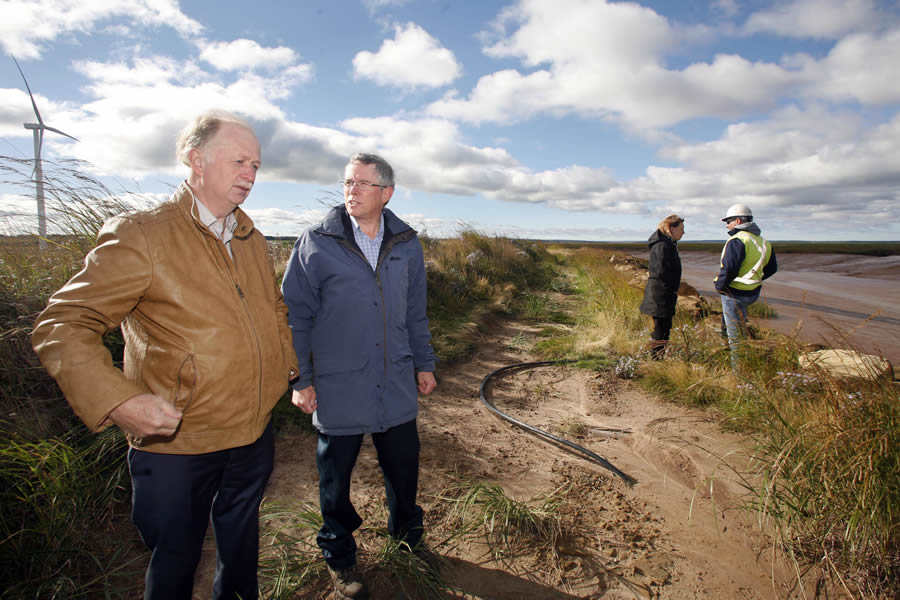 Agriculture Minister Keith Colwell, left, and Rick Giffin, of CBCL Limited, talk at the reconstruction site of the LaPanche Aboiteau near Amherst.