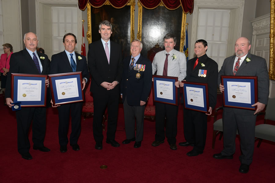 (From left) Keiren Tompkins, Stephen Ross, Premier Stephen McNeil, retired vice admiral Duncan Miller, who is chair of the Medal of Bravery Advisory Committee, Wade Smith, Shawn Hardy, David Grandy.