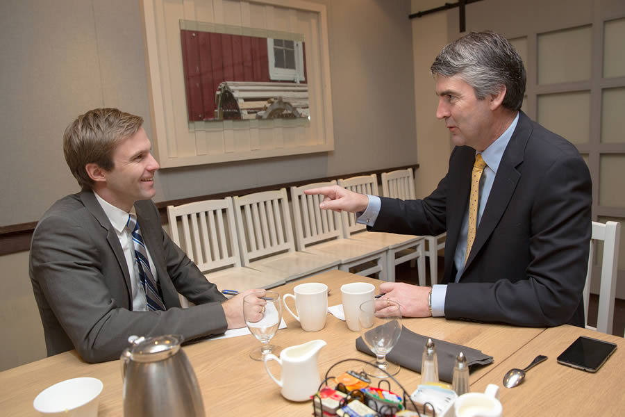 Premier Stephen McNeil and New Brunswick Premier Brian Gallant sit at a table with coffee while discussing regional collaboration and co-operation during their first official meeting.