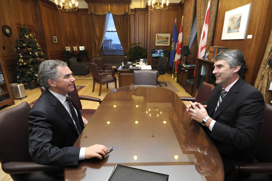Premier Stephen McNeil (right) meets with Alberta Premier Jim Prentice in Edmonton.