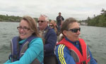 A crew of people at the announcement go on a dragon boat ride at Maskwa Aquatic Club