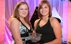Danielle Bond (left) and Jenna Myatt, of the Eastern Communities Youth Association Youth Council in Canso, hold the Excellence in Youth Leadership Award at the Celebrating Communities event in Truro.