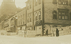 Argyle Street at the corner of George Street, Halifax, showing pine coffins supplied to Snow & Co., Undertakers, second building from right, for victims of the explosion.