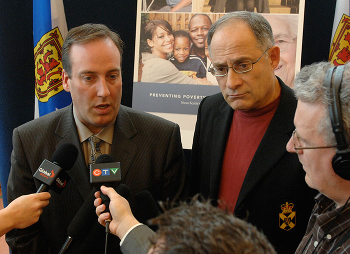 Community Services Minister Chris d'Entremont (left) and Labour and Workforce Development Minister Mark Parent take questions from media after announcing Nova Scotia's Poverty Reduction Strategy in Kentville.
