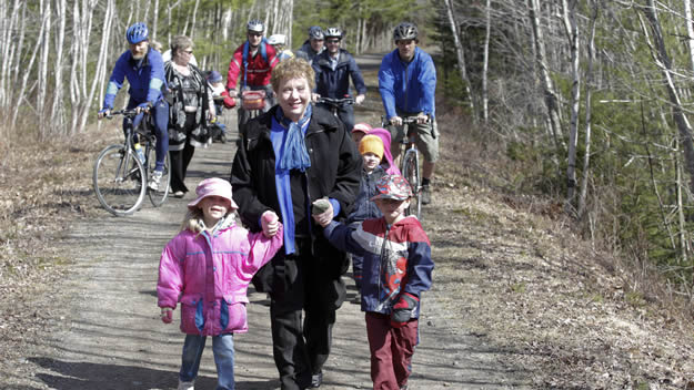 Community Services Minister Denise Peterson-Rafuse, who made the announcement of behalf of Energy Minister Charlie Parker, walks with children after the sustainable transportation announcement.